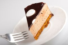 Yummy chocolate cake. Tasty chocolate cake on white plate with fork Stock Photography