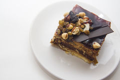 Yummy chocolate cake. Chocolate cake with almonds and walnuts Stock Photo