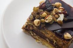 Yummy chocolate cake. Chocolate cake with almonds and walnuts Stock Photography