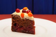 Yummy chocolate cake with fresh cranberries, sea-buckthorn and i Stock Photos