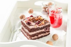 Yummy chocolate cake with walnuts and cherry Stock Images