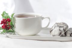 Yummy chocolate crinkle biscuits with a cup of coffee on a white background, isolated, close up. stock photo