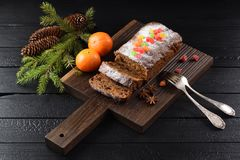 Yummy chocolate fruit cake decorated with candied fruits stock image