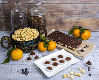 Yummy chocolate sweets with hazel nut and tangerines Stock Image
