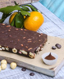 Yummy chocolate sweets with hazel nut and tangerines Stock Photos