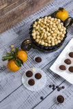 Yummy chocolate sweets with hazel nut and tangerines Royalty Free Stock Photo