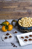 Yummy chocolate sweets with hazel nut and tangerines Stock Photography