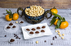 Yummy chocolate sweets with hazel nut and tangerines Royalty Free Stock Image