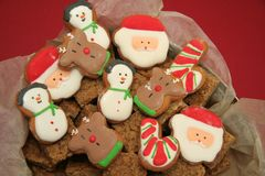 Yummy Christmas Treats. Tin full of Christmas biscuits  ready to eat Royalty Free Stock Image