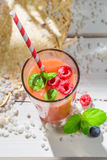 Yummy cocktail with fruits Stock Images
