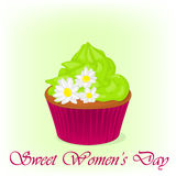 Yummy cupcake for International Women`s day with chamomiles flowers. Holiday background, poster or placard template in Stock Image