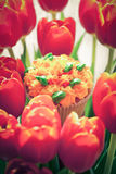 Yummy cupcake and red tulips on light background. Selective focu Royalty Free Stock Photography
