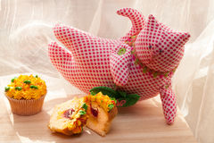 Yummy cupcake and textile cat on light background Royalty Free Stock Photo
