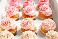 Yummy cupcakes in box. Close up Stock Photo
