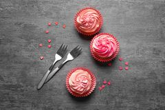 Yummy cupcakes and forks. On grey background Royalty Free Stock Image