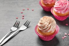 Yummy cupcakes and forks. On grey background Stock Image