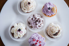 Yummy cupcakes on the plate Royalty Free Stock Images