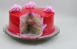 Yummy cut strawberry birthday cake isolated on white background Royalty Free Stock Image