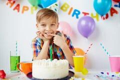 Yummy. Cute boy tasting yummy birthday dessert Royalty Free Stock Image