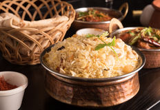 Yummy delicious biryani in a round brass bowl. Royalty Free Stock Photography