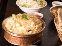 Yummy delicious biryani in a round brass bowl. Royalty Free Stock Photos