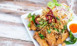 Delicious, fried wing chicken with herb, pepper, chilli, salad, and sauce, famous thai or asian food. Yummy, delicious, fried wing chicken with herb, pepper stock image