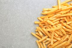 Yummy french fries. On grey background Royalty Free Stock Image