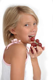 Yummy Fruit. Little girl eats healthy fruit and chooses better snacks than sugar or candy. Teaching children about healthier diets Stock Photos