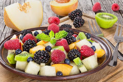 Yummy fruit and berry summer dessert salad Royalty Free Stock Photography