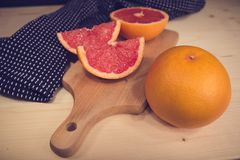 Tasty and healthy grapefruit. Yummy grapefruit in section and whole - healthy - vintage - nostalgia Royalty Free Stock Photography