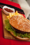 Yummy. Hamburger and french fries with ketchup stock images