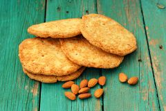Yummy homemade almond cookies with whole almonds on turquoise sh Stock Image