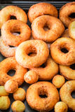 Yummy and homemade golden donuts freshly baked. Closeup of yummy and homemade golden donuts freshly baked Stock Images
