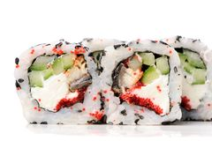 Yummy Japanese fusion rolls with sesame seeds topped with red ro Royalty Free Stock Images