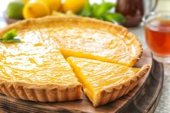 Yummy lemon tart. On wooden tray Royalty Free Stock Images