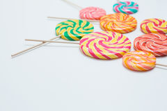 Yummy lollipops on sticks on white table. Sweet caramel candy. C. Opy space. Celebration concept. Selective focus Stock Photo