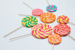 Yummy lollipops on sticks on white table. Sweet caramel candy. C. Opy space. Celebration concept. Selective focus Royalty Free Stock Image