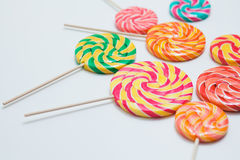 Yummy lollipops on sticks on white table. Sweet caramel candy. C. Opy space. Celebration concept. Selective focus. Horizontal Stock Photo