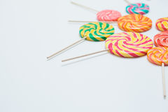 Yummy lollipops on sticks on white table. Sweet caramel candy. C. Opy space. Celebration concept. Selective focus. Horizontal Stock Photography