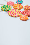 Yummy lollipops on sticks on white table. Sweet caramel candy. C. Opy space. Celebration concept. Selective focus. Vertical shot Stock Image