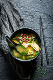 Yummy miso soup with salmon in black bowl Royalty Free Stock Photography