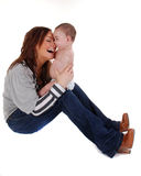Yummy Mummy!. A cute baby boy, laughing, in the arms of his mother stock photo
