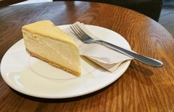Yummy New York Cheese cake with silver spoon Stock Photo