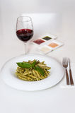Yummy pasta served with red wine Stock Image