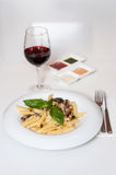 Yummy pasta served with red wine Royalty Free Stock Image