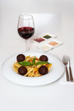 Yummy pasta served with red wine Stock Photos