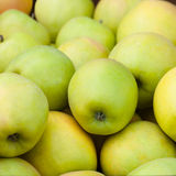 Yummy pile of apples in market stall Stock Photo