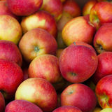 Yummy pile of apples in market stall Royalty Free Stock Photo