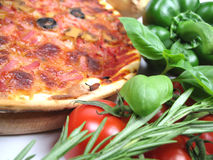 Yummy pizza. A pizza and some fresh ingredients Royalty Free Stock Photography