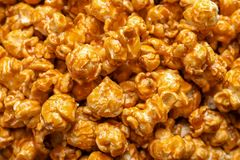 Yummy popcorn with caramel. As background Royalty Free Stock Photo
